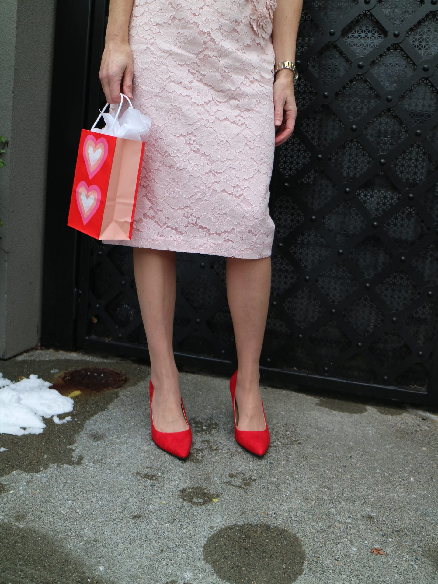 pink lace dress with red shoes