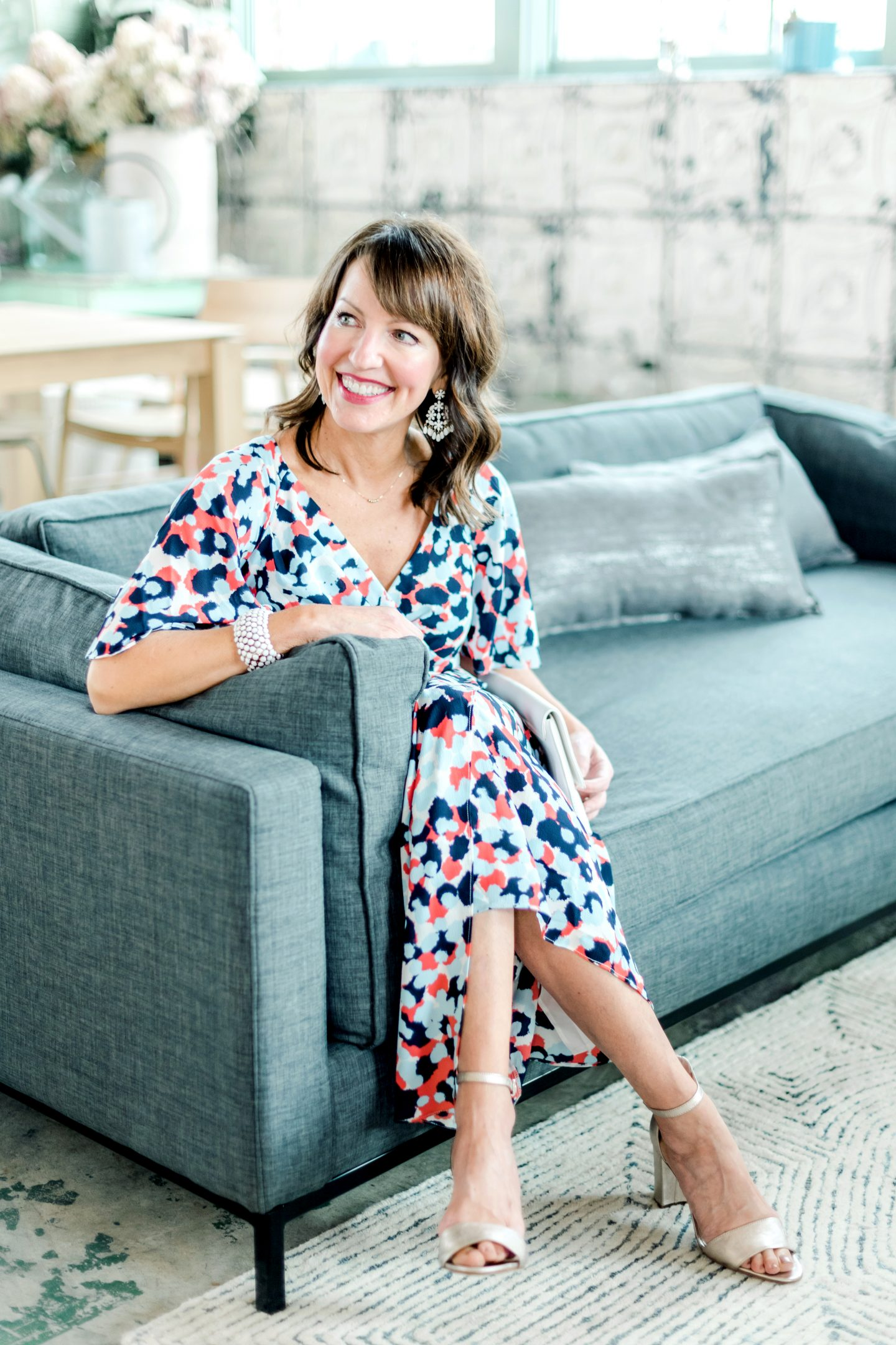 seated on couch in patterned dress