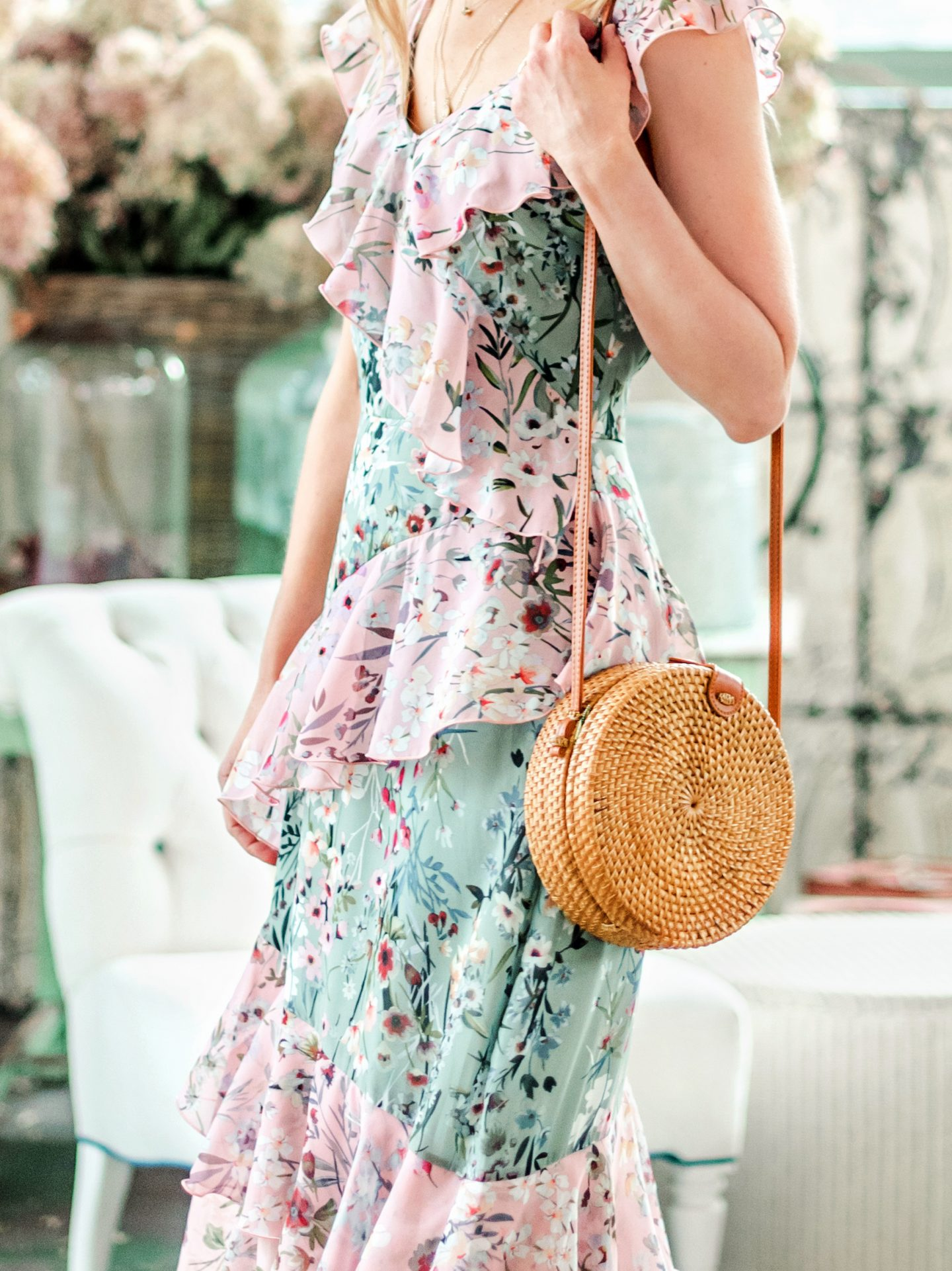 floral dress with circle straw purse
