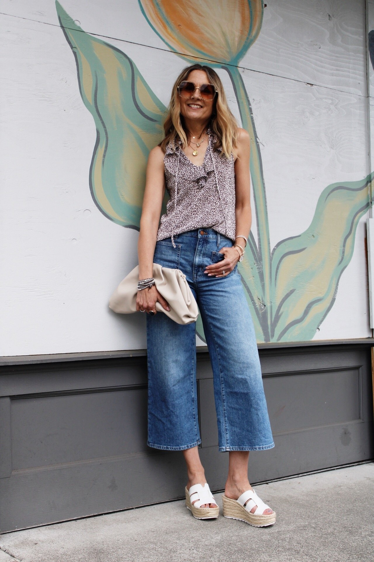 sleeveless ruffle top with wide leg crop denim