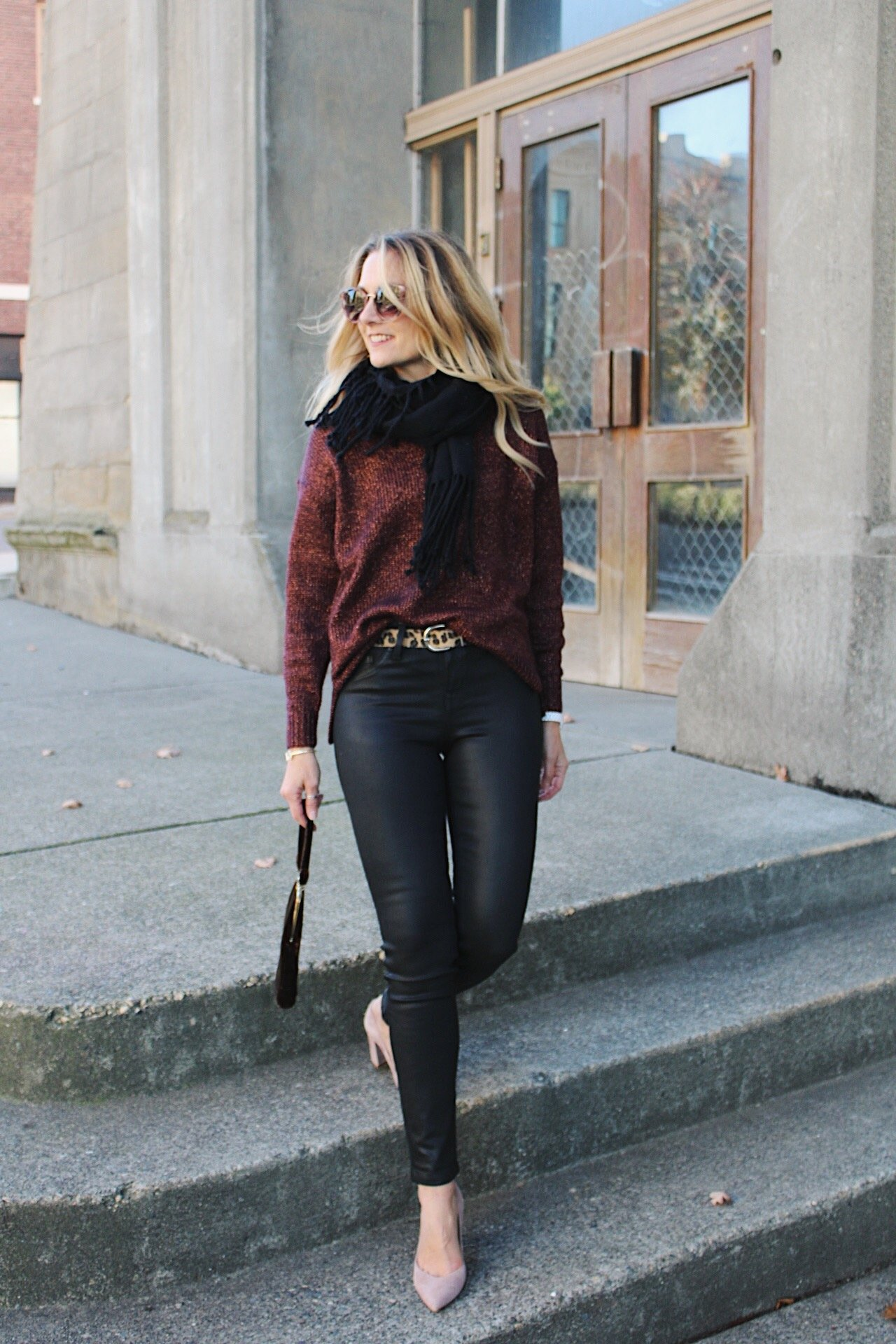 glitter sweater with leopard belt and coated black jeans and suede pumps
