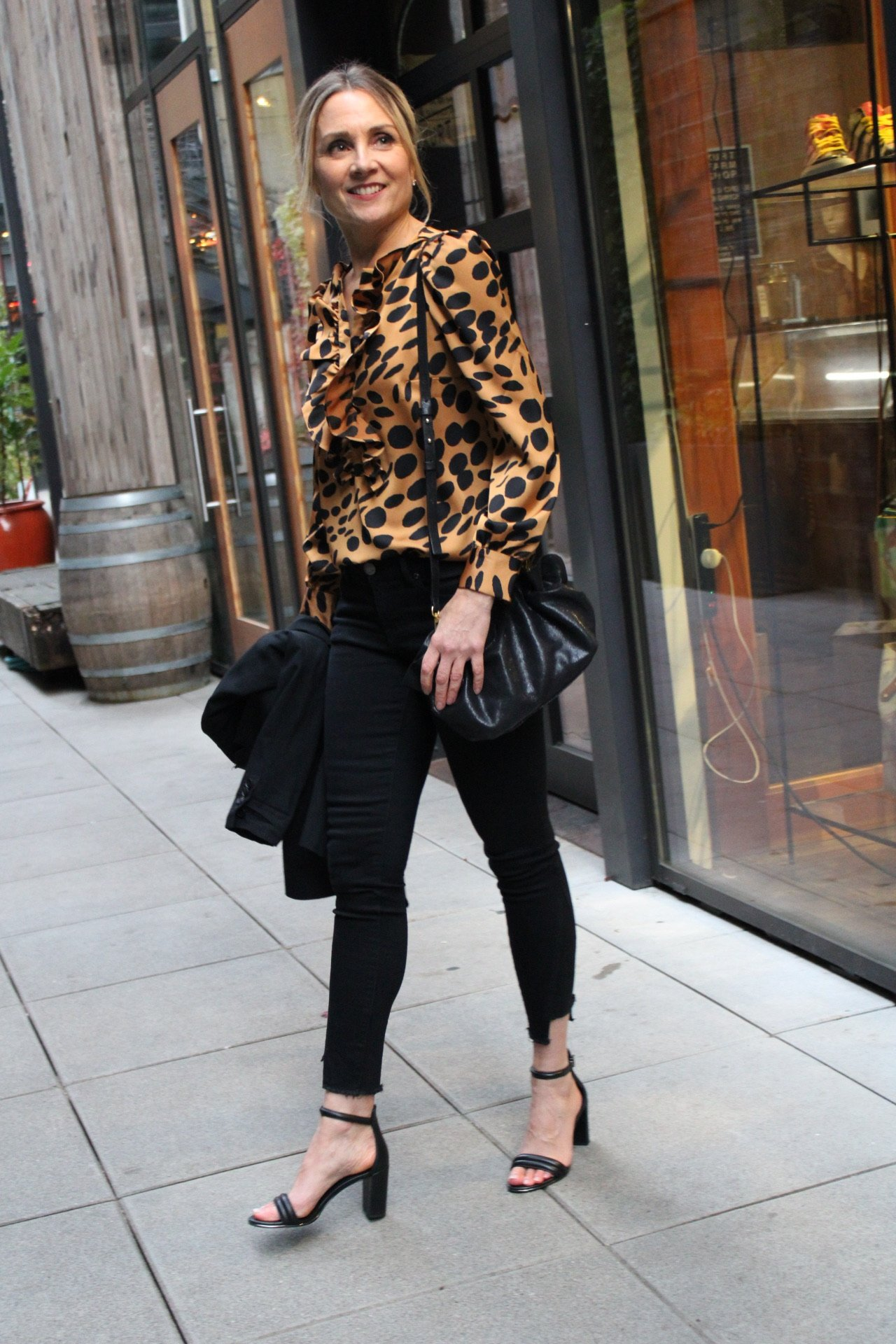 leopard top with black jeans and black heels