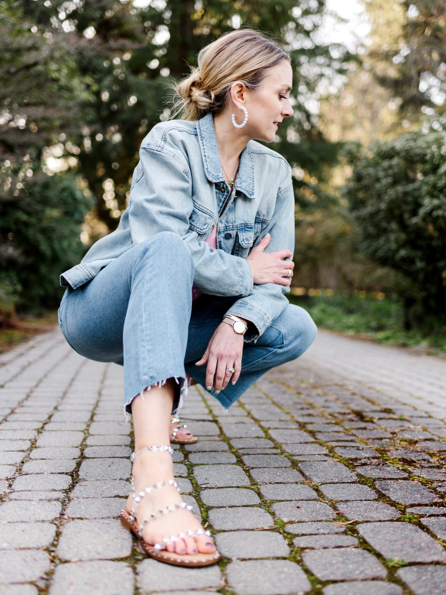 denim on denim outfit with studded sandals and pearl hoop statement earrings