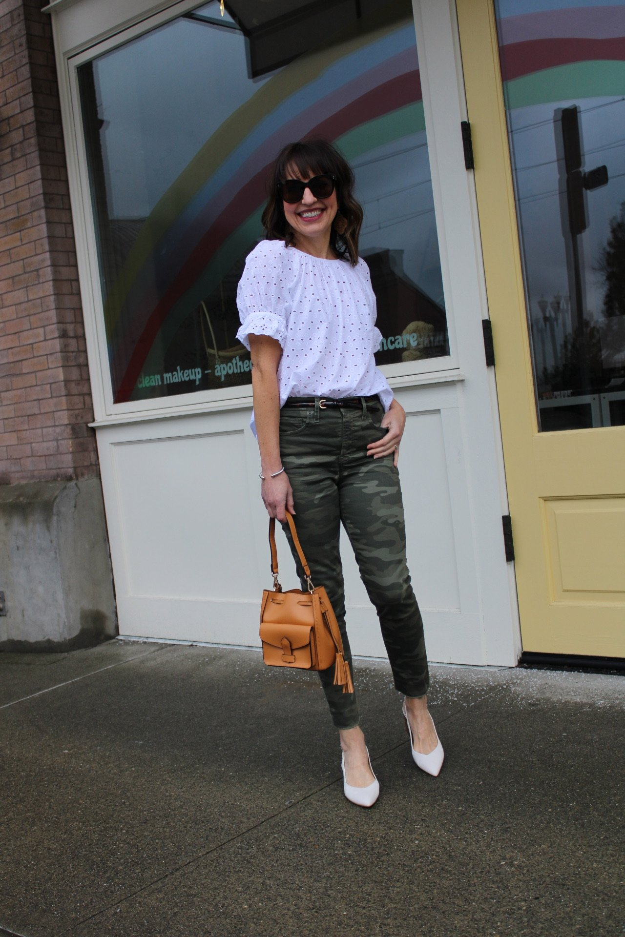 camo pants with white eyelet top and white slingback flats