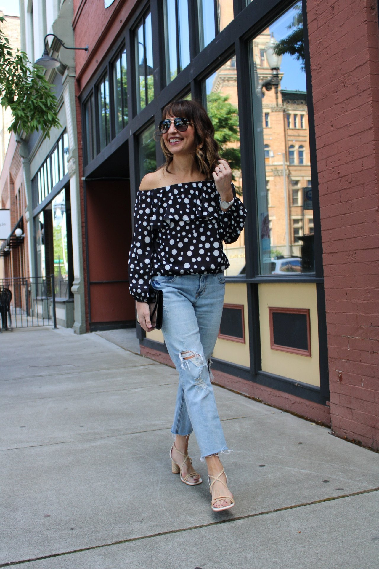 polka dot off the shoulder top with lightwash distressed jeans and beige sandals