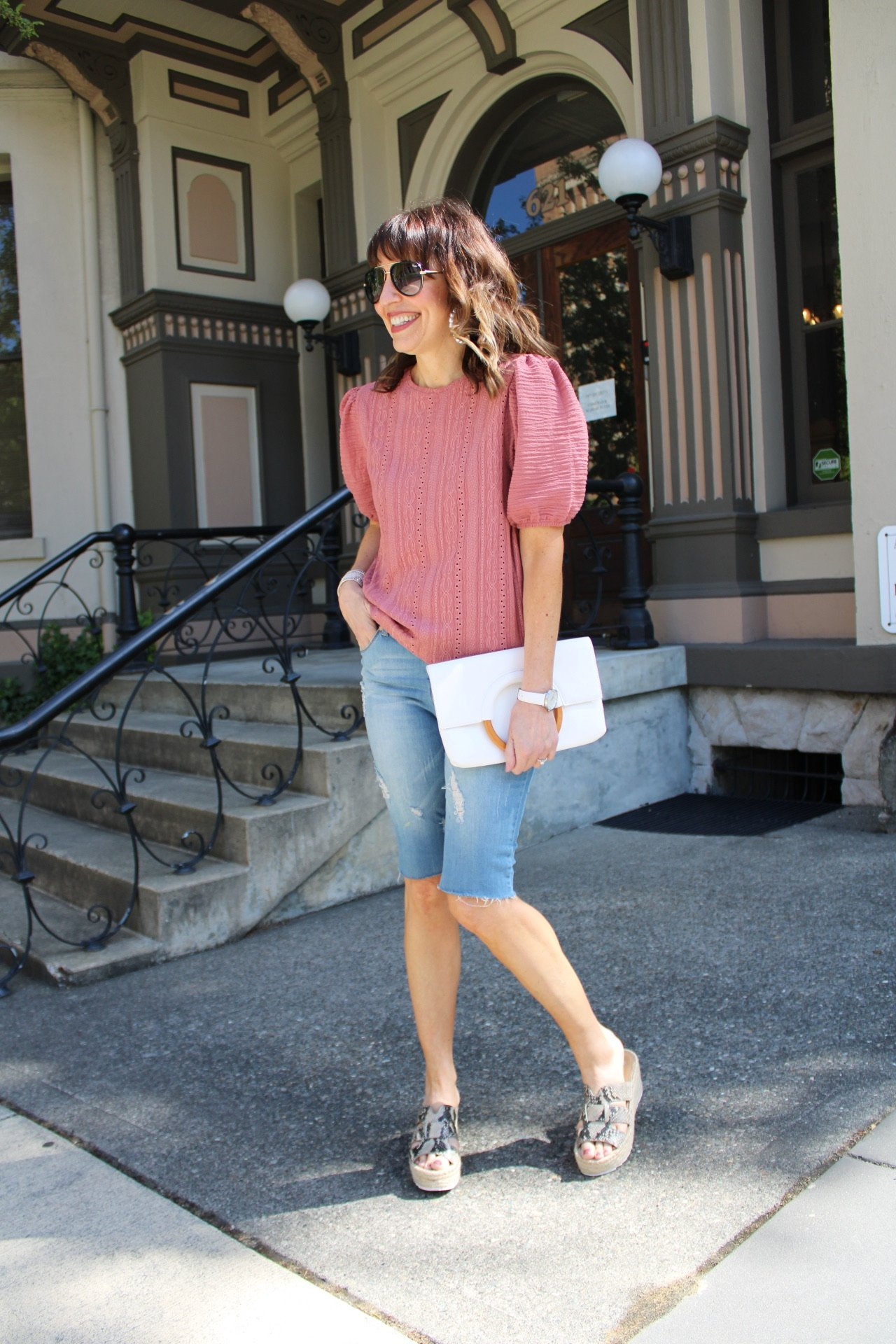 pink puff sleeve top with denim bermuda shorts and snakeskin wedges