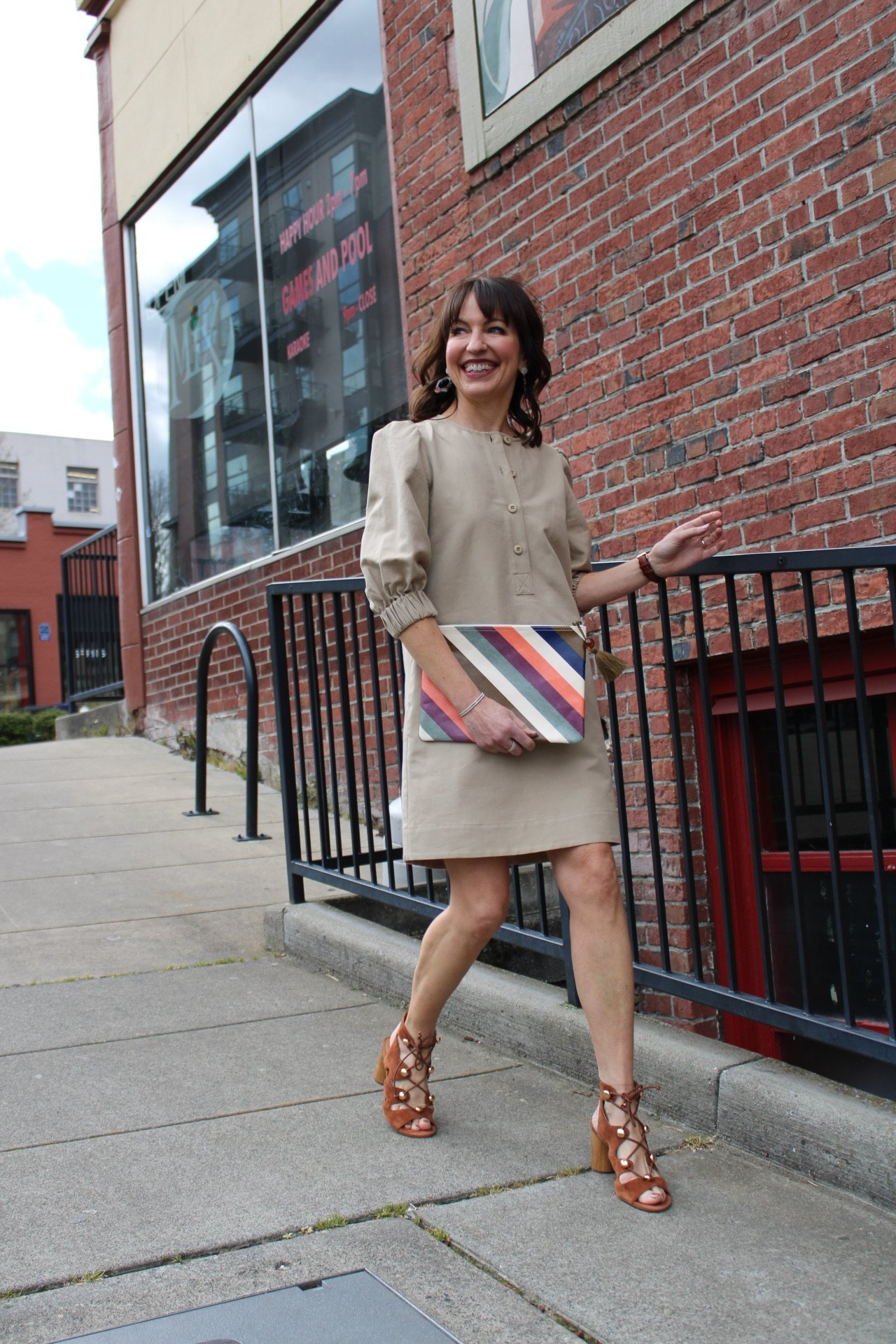 beige rebecca minkoff modern puff sleeve dress with brown peeptoe booties and striped clutch