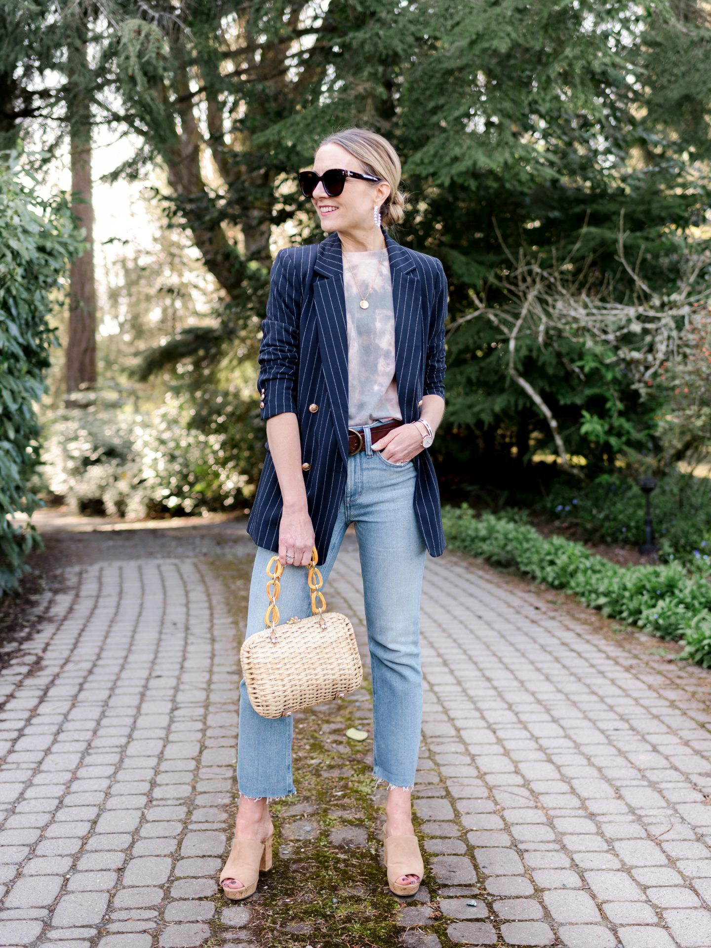 tie dye tee with raw hem cropped jeans and pinstripe navy blazer and mule heels and wicker basket frances valentine bag