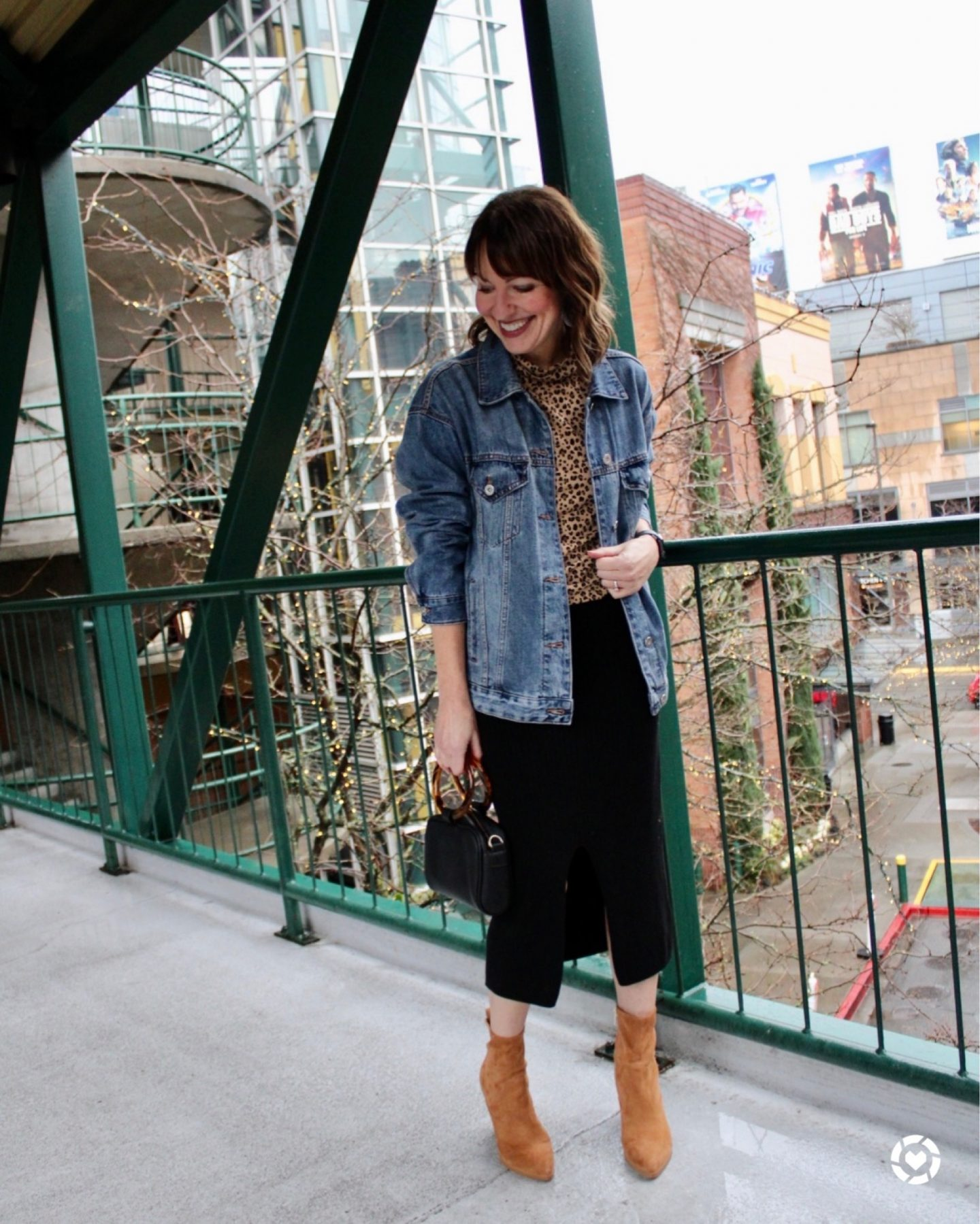 leopard top with denim jacket and midi sweater skirt and camel booties