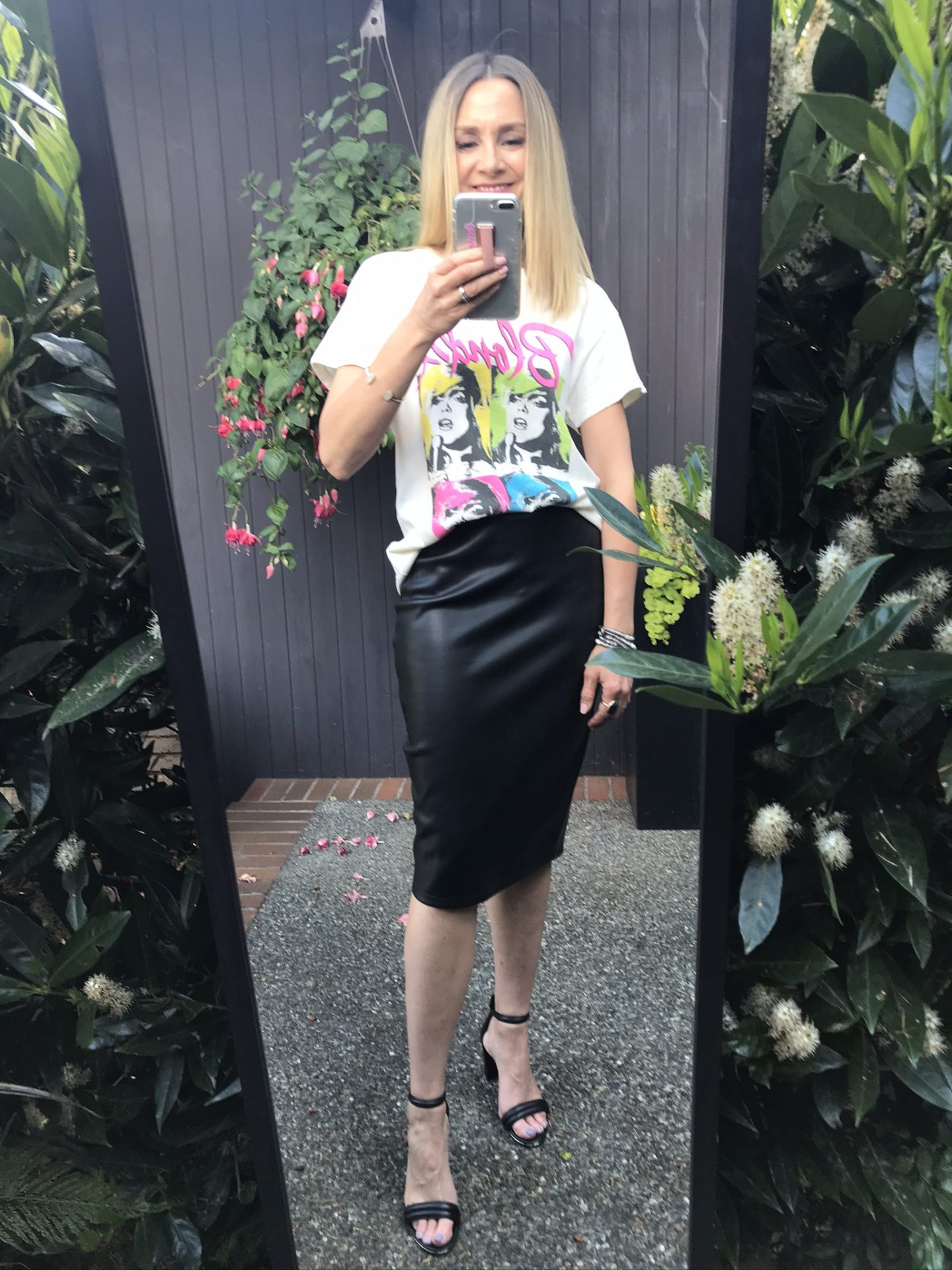 mirror selfie with blondie graphic tee and faux leather pencil skirt and black heels