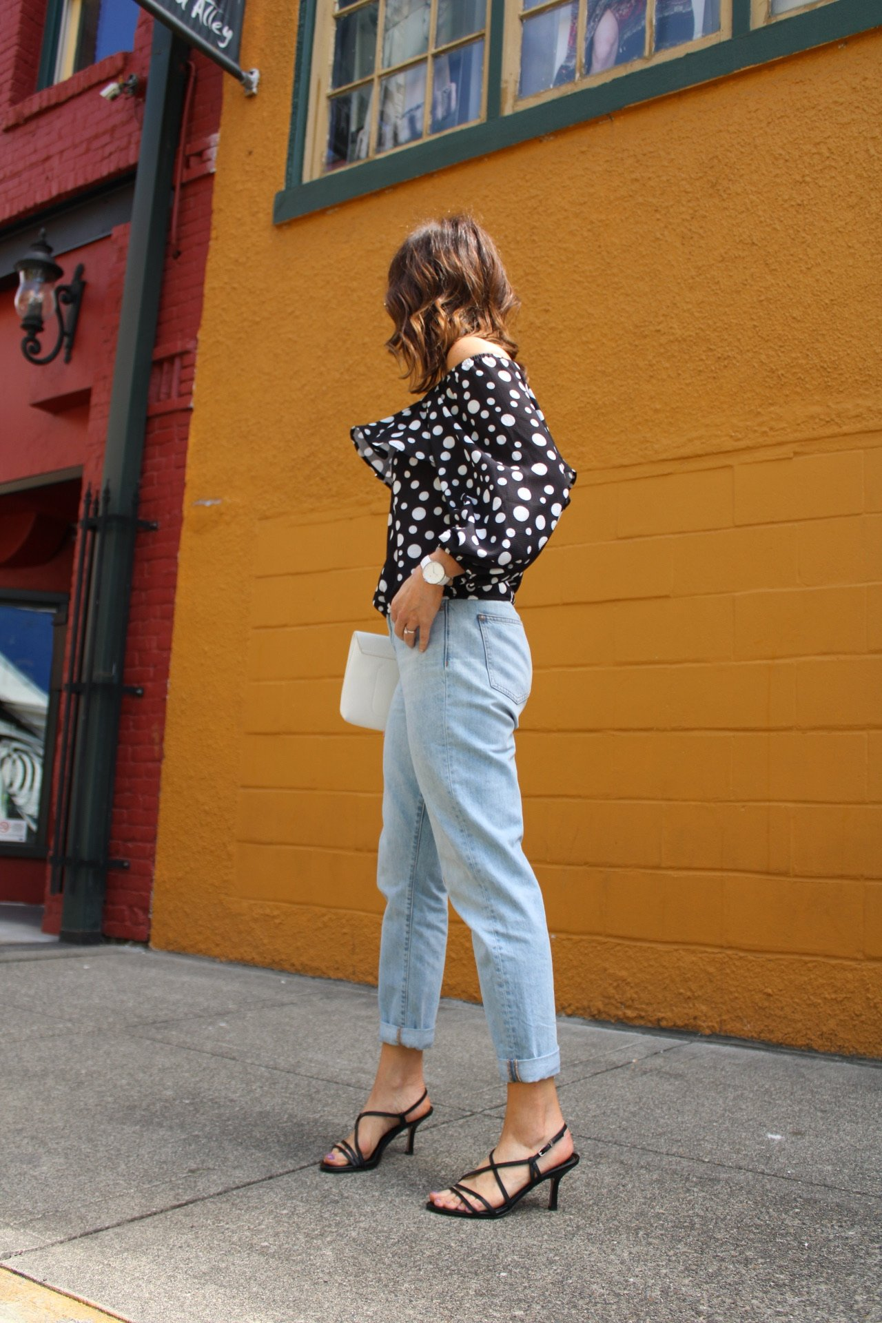 polka dot top with lightwash denim and strappy black sandals