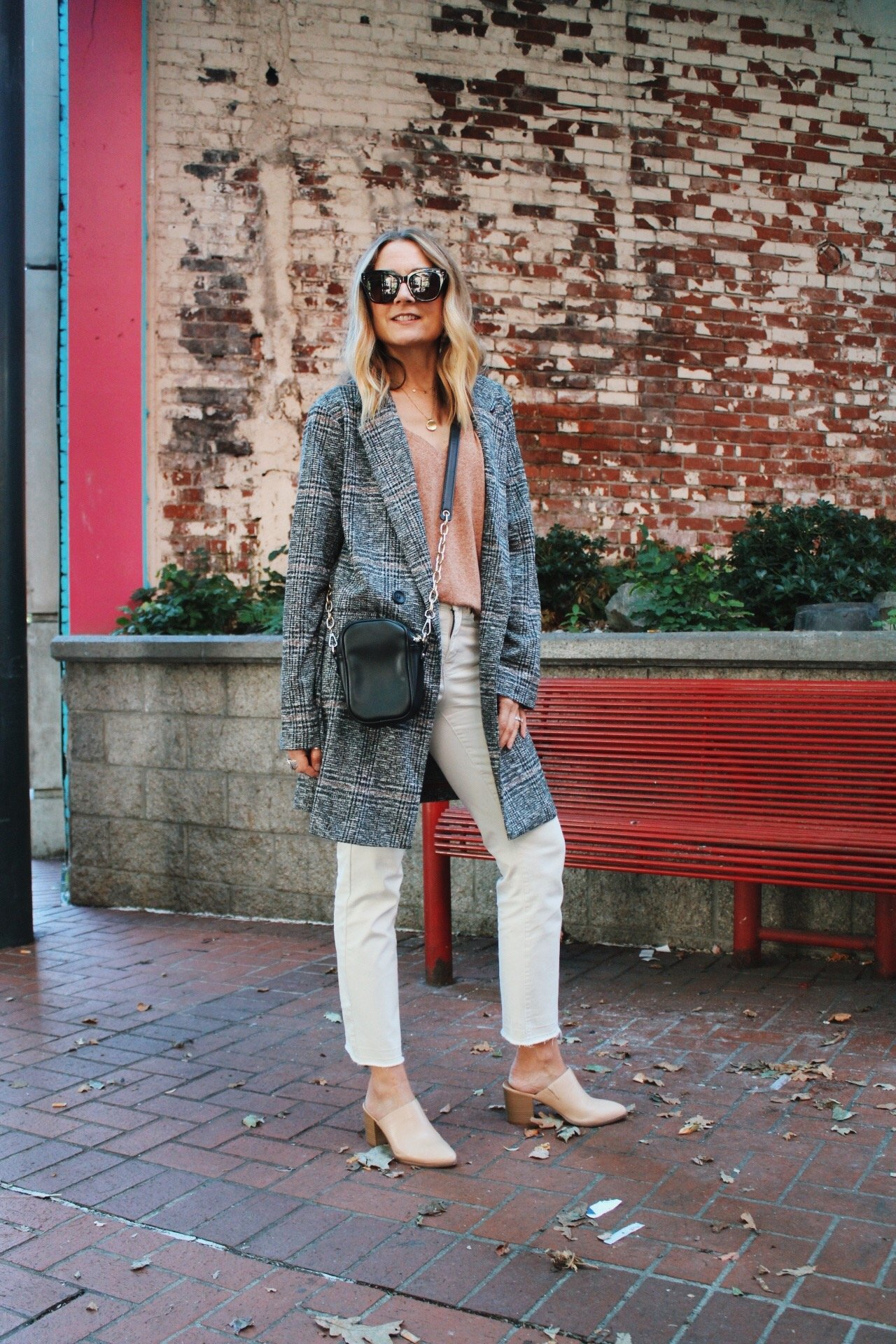 plaid coat with winter white jeans and tan mules