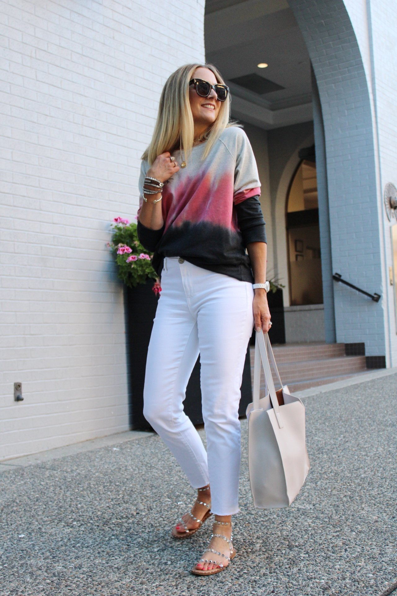 tie dye sweatshirt and white jeans