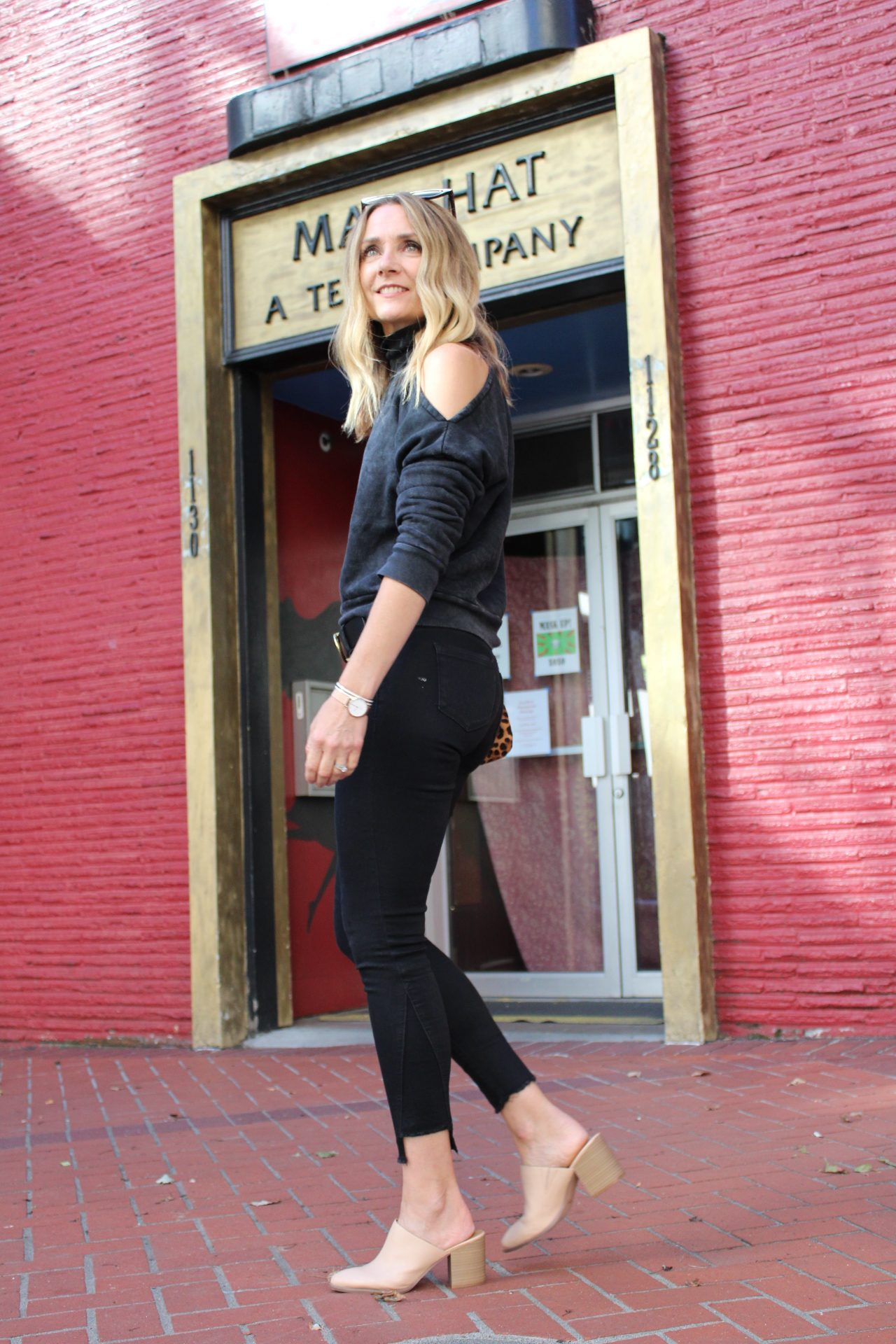 black top with black jeans and tan heeled mules