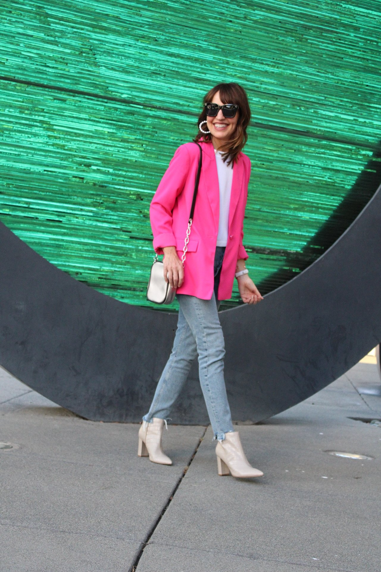 pink blazer with agolde jeans and white boots
