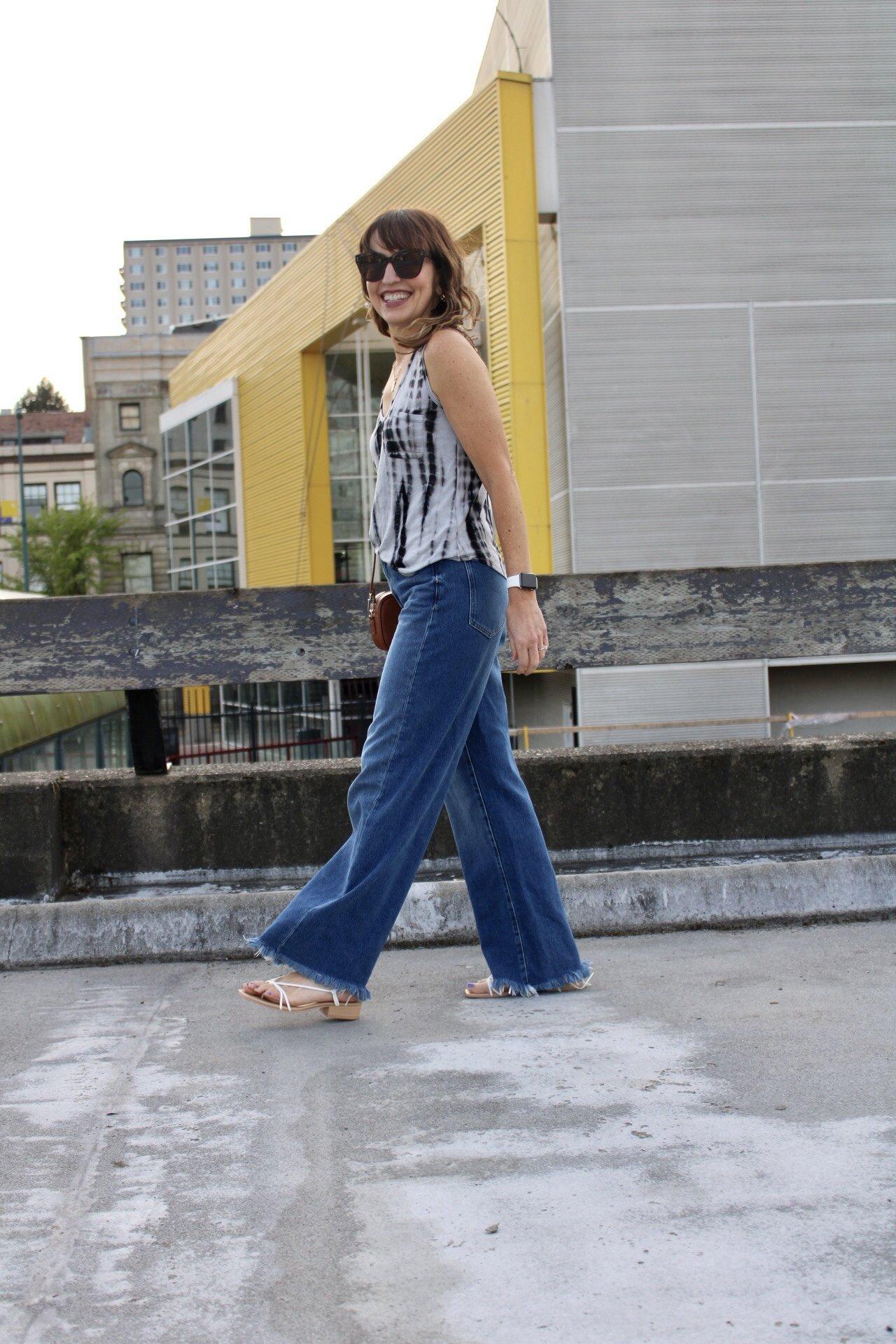 tie dye tank and wide leg jeans